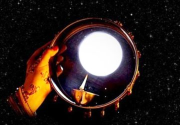 karva chauth 2019 women look at moon through sieve