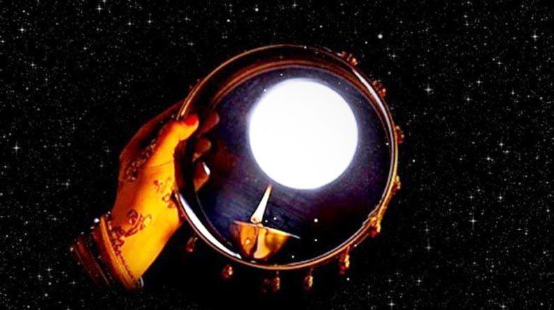 karva chauth 2019 women look at moon through sieve